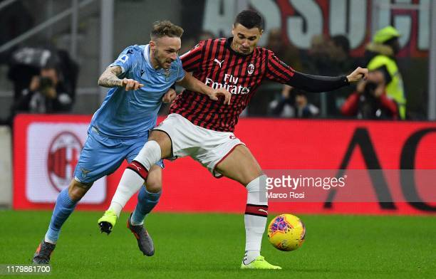 Manuel Lazzari of SS Lazio compete for the ball with Rade Krunicof AC Milan during the Serie A match between AC Milan and SS Lazio at Stadio Giuseppe...