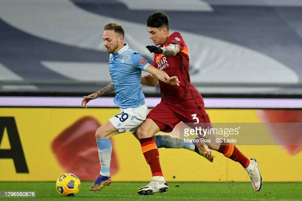 Manuel Lazzari of SS Lazio compete for the ball with Roger Ibanez of AS Roma during the Serie A match between SS Lazio and AS Roma at Stadio Olimpico...