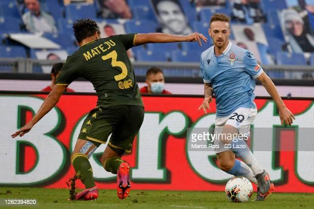 Manuel Lazzari of SS Lazio competes for the ball with Alex Mateju of Brescia Calcio during the Serie A match between SS Lazio and Brescia Calcio at...