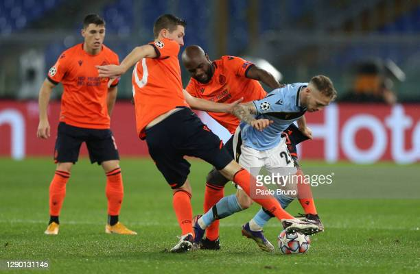 Manuel Lazzari of SS Lazio is challenged by Eder Alvarez Balanta and Hans Vanaken both of Club Brugge during the UEFA Champions League Group F stage...