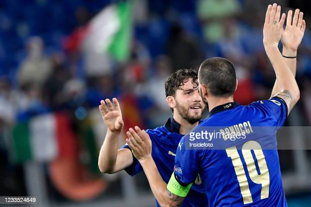 Manuel Locatelli and Leonardo Bonucci of Italy celebrate the victory at the end of the Uefa Euro 2020 Group A football match between Italy and...