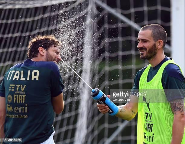 Manuel Locatelli and Leonardo Bonucci of Italy in action during a Italy training session at Centro Tecnico Federale di Coverciano on June 14, 2021 in...