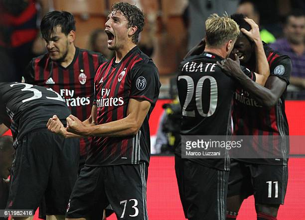 Manuel Locatelli of AC Milan celebrates his teammates goal Gabriel Paletta during the Serie A match between AC Milan and US Sassuolo at Stadio...