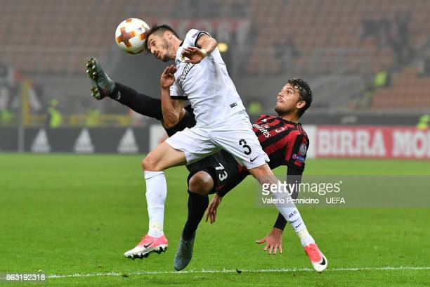 Manuel Locatelli of AC Milan clashes with Helder Lopes of AEK Athens during the UEFA Europa League group D match between AC Milan and AEK Athen on...