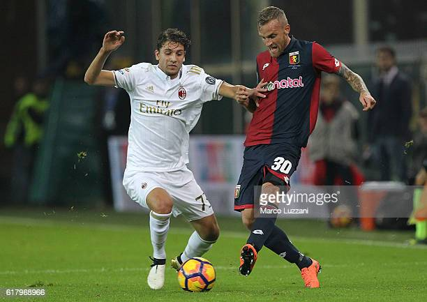 Manuel Locatelli of AC Milan competes for the ball with Luca Rigoni of Genoa CFC during the Serie A match between Genoa CFC and AC Milan at Stadio...