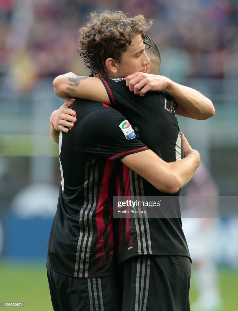 Manuel Locatelli of AC Milan (L) embraces Gianluca Lapadula of AC Milan during the Serie A match between AC Milan and US Citta di Palermo at Stadio Giuseppe Meazza on April 9, 2017 in Milan, Italy.