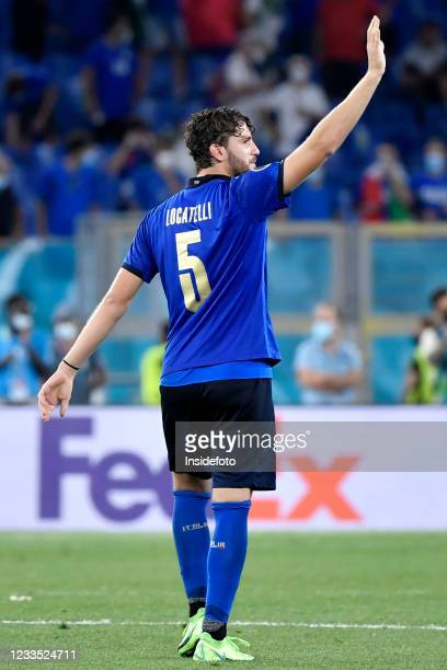 Manuel Locatelli of Italy celebrates the victory at the end of the Uefa Euro 2020 Group A football match between Italy and Switzerland. Italy won 3-0...
