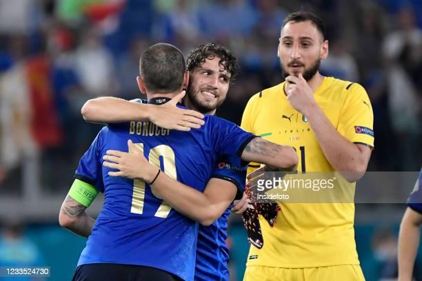 Manuel Locatelli of Italy celebrates the victory with Leonardo Bonucci and Gianluigi Donnarumma at the end of the Uefa Euro 2020 Group A football...