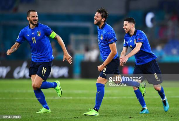 Manuel Locatelli of Italy celebrates with Leonardo Bonucci and Jorginho after scoring their side's second goal during the UEFA Euro 2020 Championship...