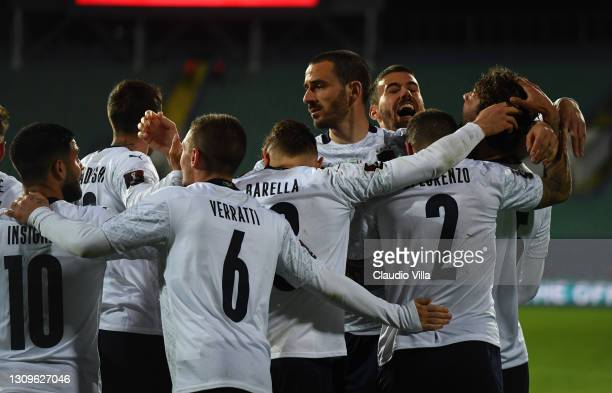 Manuel Locatelli of Italy celebrates with team mates after scoring the opening goal during the FIFA World Cup 2022 Qatar qualifying match between...