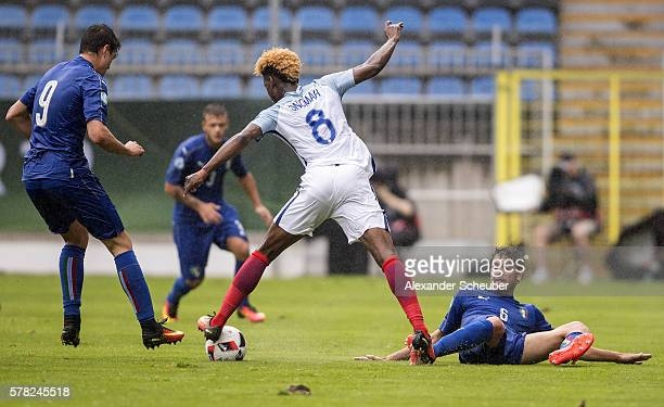 Manuel Locatelli of Italy challenges Joshua Onomah of England during the U19 Match between England and Italy at Carl-Benz-Stadium on July 21, 2016 in...