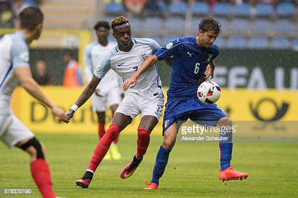 Manuel Locatelli of Italy challenges Tammy Abraham of England during the U19 Match between England and Italy at Carl-Benz-Stadium on July 21, 2016 in...