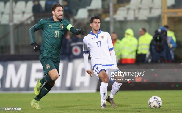 Manuel Locatelli of Italy competes for the ball with Aram khamoyan of Armenia during the UEFA U21 European Championship Qualifier match between Italy...