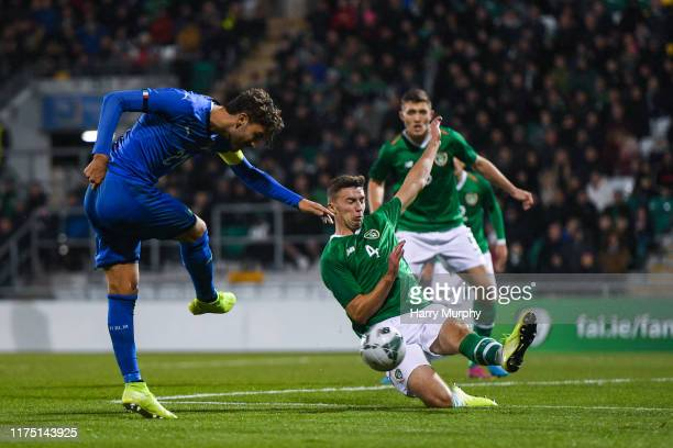 Manuel Locatelli of Italy has a shot blocked by Conor Masterson of Republic of Ireland during the UEFA U21 Championships Qualifier match between the...