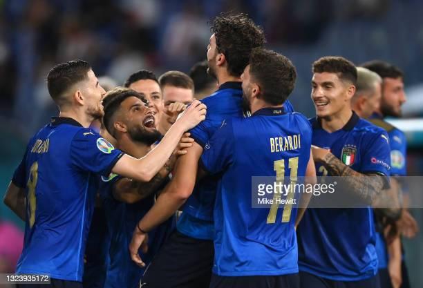 Manuel Locatelli of Italy is congratulated on scoring the first goal by Jorginho, Lorenzo Insigne, Domenico Berardi and Giovanni Di Lorenzo during...