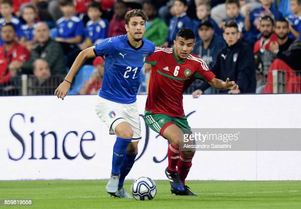 Manuel Locatelli of Italy U21 competes for the ball whit Anas Bach of Marocco U21 during the international friendly match between Italy U21 and...