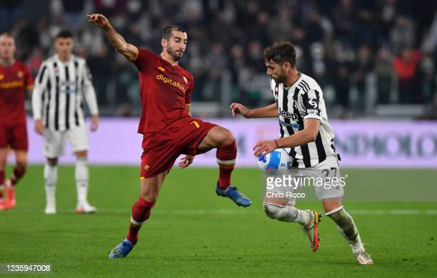 Manuel Locatelli of Juventus challenged by Henrikh Mkhitaryan of AS Roma during the Serie A match between Juventus and AS Roma at Allianz Stadium on...