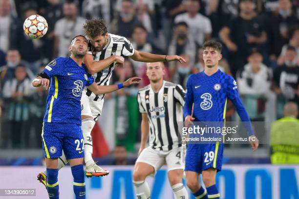 Manuel Locatelli of Juventus jumps for the ball against Hakim Ziyech of Chelsea during the UEFA Champions League group H match between Juventus and...