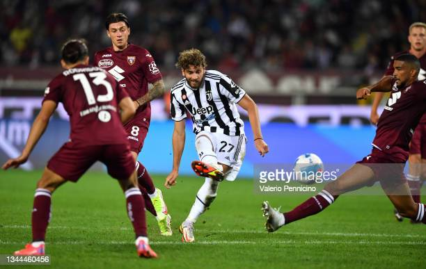 Manuel Locatelli of Juventus scores their team's first goal during the Serie A match between Torino FC v Juventus at Stadio Olimpico di Torino on...