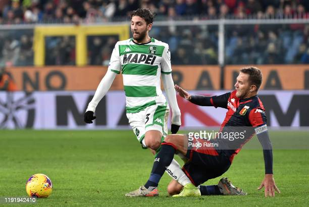 Manuel Locatelli of US Sassuolo competes with Domenico Criscito of Genoa CFC during the Serie A match between Genoa CFC and US Sassuolo at Stadio...