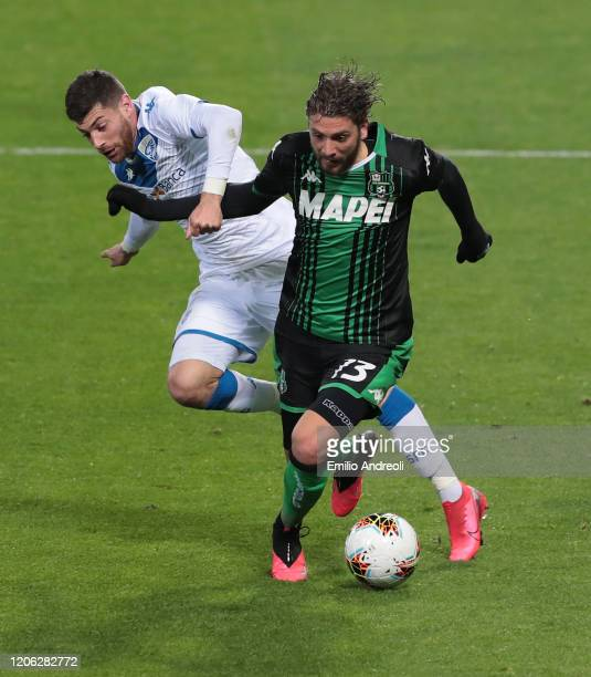 Manuel Locatelli of US Sassuolo is challenged by Stefano Sabelli of Brescia Calcio during the Serie A match between US Sassuolo and Brescia Calcio at...