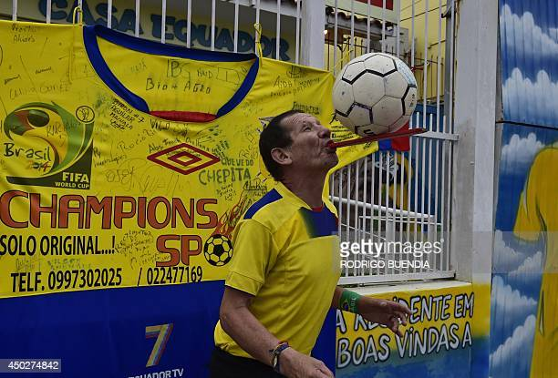 Manuel Loor fan of Ecuador performs tricks as he prepares to welcome the Ecuadorian football team in Viamao on June 8 a few days prior to the start...