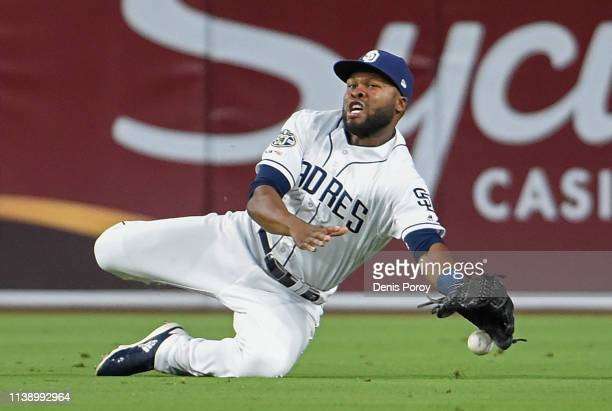 Manuel Margot of the San Diego Padres can't make the catch on a ball that went for a double off the bat of Dee Gordon of the Seattle Mariners in the...