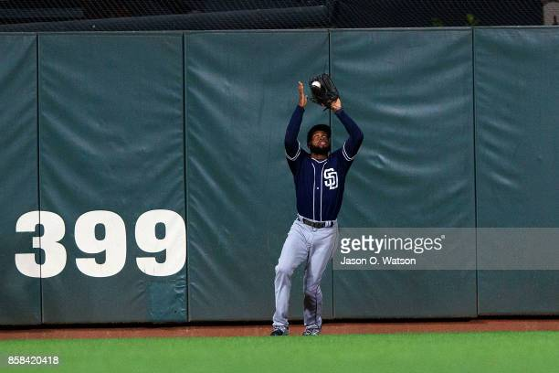 Manuel Margot of the San Diego Padres catches a fly ball against the San Francisco Giants during the first inning at ATT Park on September 29 2017 in...
