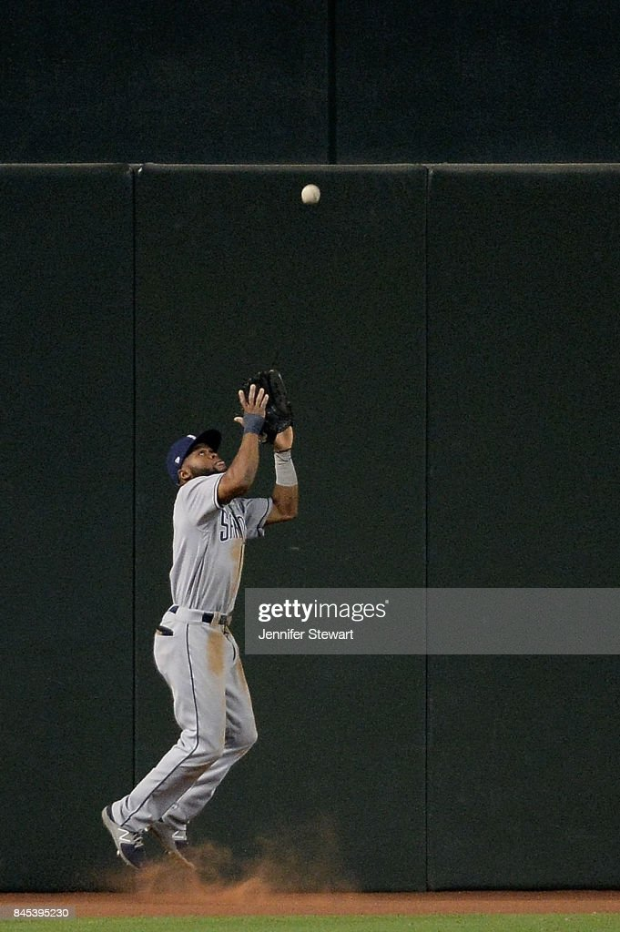 Manuel Margot #7 of the San Diego Padres catches a fly ball in the MLB game against the Arizona Diamondbacks at Chase Field on September 10, 2017 in Phoenix, Arizona.