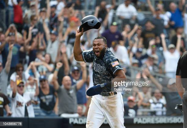 Manuel Margot of the San Diego Padres celebrates as he scores the game winning run during the tenth inning of a baseball game against the Arizona...