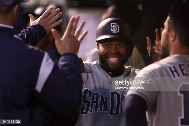 Manuel Margot of the San Diego Padres celebrates in the dugout after scoring on a Clayton Richard home run in the fourth inning against the Colorado...