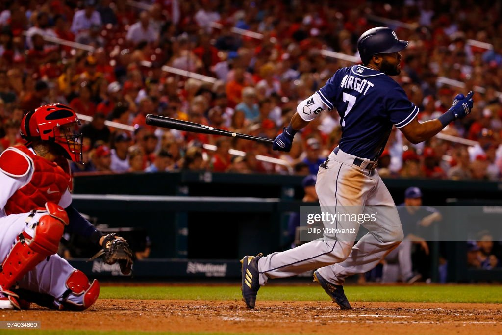 Manuel Margot #7 of the San Diego Padres drives in a run with a triple against the St. Louis Cardinals in the sixth inning at Busch Stadium on June 13, 2018 in St. Louis, Missouri.