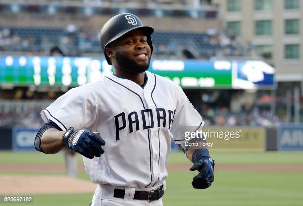 Manuel Margot of the San Diego Padres heads into the dugout after hitting a solo home run during the first inning of a baseball game against the New...