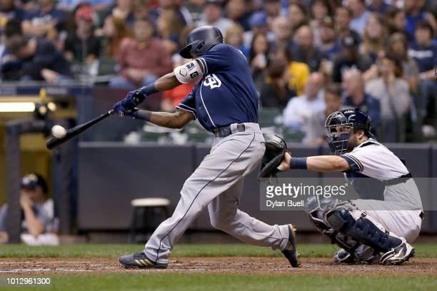 Manuel Margot of the San Diego Padres hits a home run in the fifth inning against the Milwaukee Brewers at Miller Park on August 7 2018 in Milwaukee...