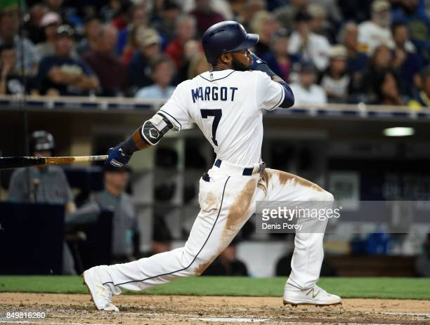 Manuel Margot of the San Diego Padres hits a single during the second inning of a baseball game against the Arizona Diamondbacks at PETCO Park on...