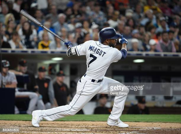 Manuel Margot of the San Diego Padres hits a threerun home run during the fourth inning of a baseball game against the San Francisco Giants at PETCO...