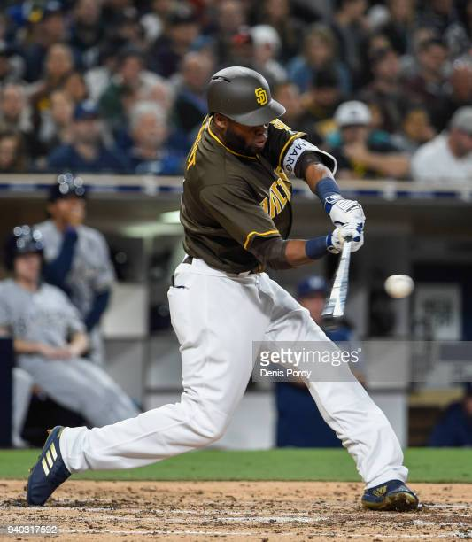 Manuel Margot of the San Diego Padres hits an RBI single during the fourth inning of a baseball game against the Milwaukee Brewers at PETCO Park on...