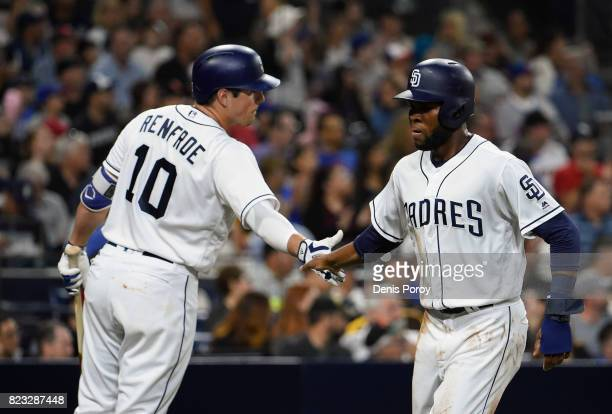 Manuel Margot of the San Diego Padres is congratulated by Hunter Renfroe after scoring during the third inning of a baseball game against the New...