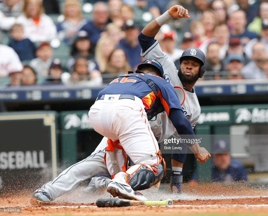 Manuel Margot #7 of the San Diego Padres is tagged out by Max Stassi #12 of the Houston Astros in the fifth inning at Minute Maid Park on April 8, 2018 in Houston, Texas.