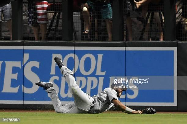 Manuel Margot of the San Diego Padres is unable to make the diving catch in the second inning of the MLB game against the Arizona Diamondbacks at...