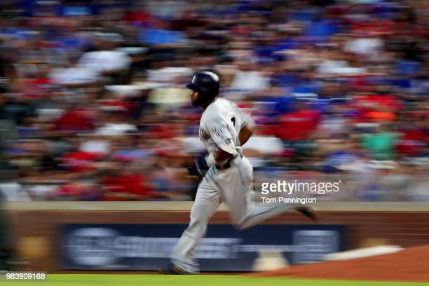 Manuel Margot of the San Diego Padres rounds the bases after hitting a threerun home run against the Texas Rangers in the top of the fifth inning at...