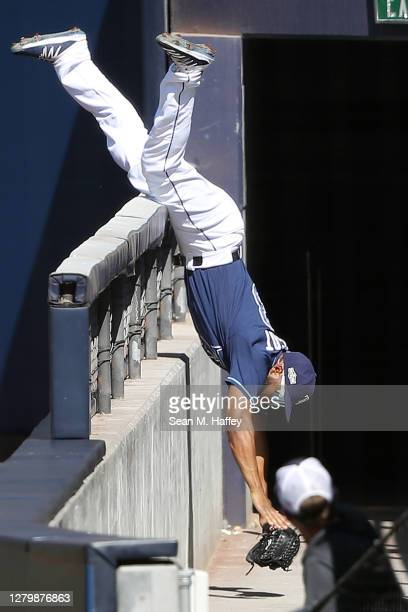 Manuel Margot of the Tampa Bay Rays catches a fly ball as he crashes over the wall on a foul by George Springer of the Houston Astros during the...