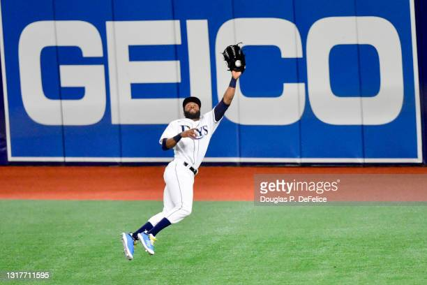 Manuel Margot of the Tampa Bay Rays catches a fly ball during the eighth inning against the New York Yankees at Tropicana Field on May 12, 2021 in St...