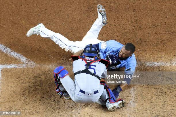 Manuel Margot of the Tampa Bay Rays is tagged out by Austin Barnes of the Los Angeles Dodgers on an attempt to steal home during the fourth inning in...
