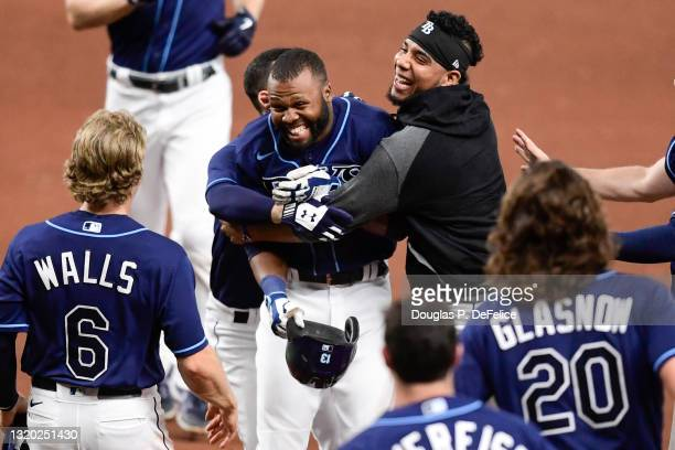 Manuel Margot of the Tampa Bay Rays reacts with his teammates after hitting an RBI single during the tenth inning to defeat the Kansas City Royals...