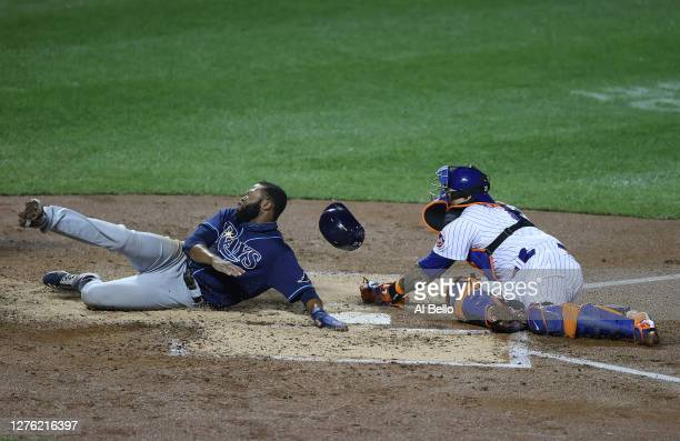 Manuel Margot of the Tampa Bay Rays scores against Wilson Ramos of the New York Mets in the third inning during their game at Citi Field on September...
