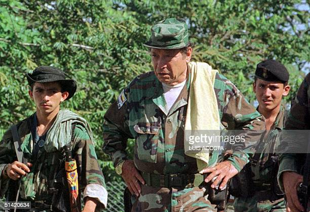 """Manuel Marulanda """"Fixed Shot"""" , chief leader, along with other unidentified members of the Revolutionary Armed Forces of Colombia participates in an..."""