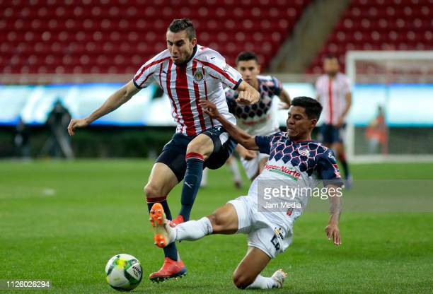 Manuel Mayorga of Chivas competes for the ball with Martin Orozco of Cimarrones during a match between Chivas and Cimarrones as part of the Copa MX...