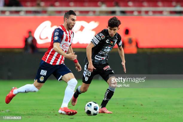 Manuel Mayorga of Chivas fights for the ball with Francisco Figueroa of Pachuca during the 9th round match between Chivas and Pachuca as part of the...