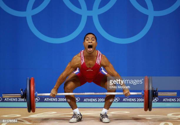 Manuel Minginfel of Micronesia competes in the men's 62 kg Group B category weightlifting competition on August 16, 2004 during the Athens 2004...